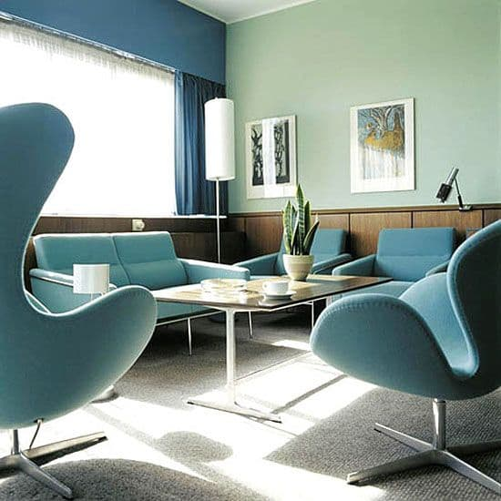 Arne jacobsen s holistic architectural and design approach for Royal interior living room