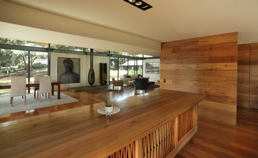 seeley architects - lauriston australian modern house - living room view from modern kitchen