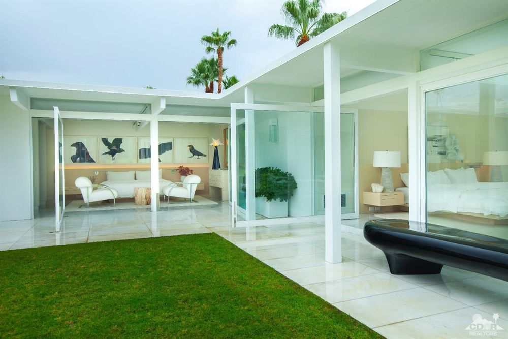 A mid century white palm springs oasis mid century home for Mid century modern furniture palm springs