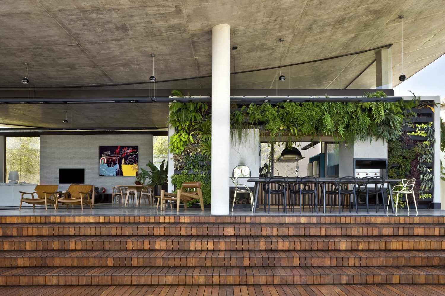 climbing house - contemporary house in Brazil by leo romano - dining and living area