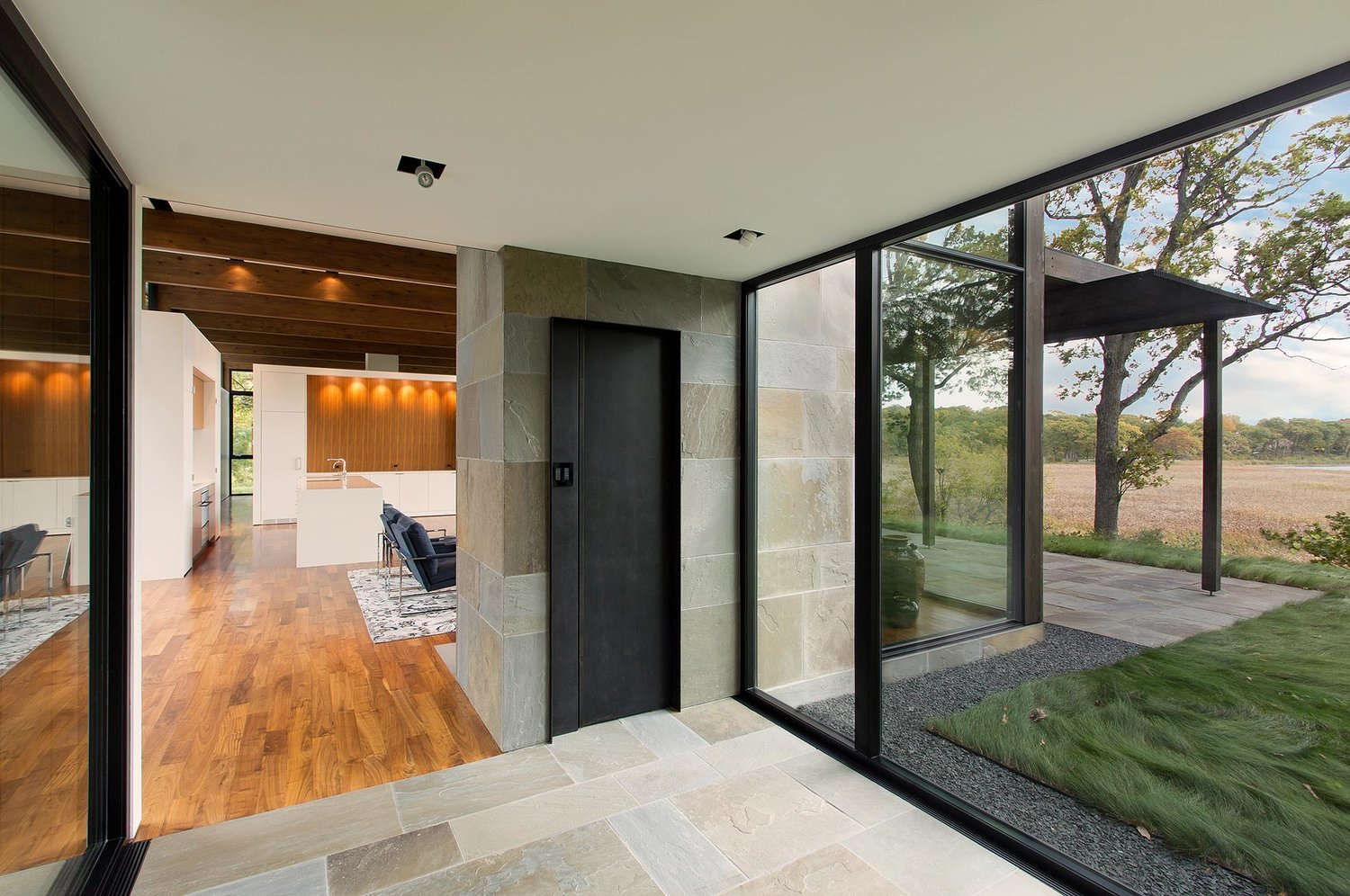 Modernist Woodland House - Altus architecture - inside entrance view